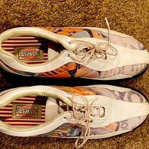 FootJoy woman's soft spike golf shoes.